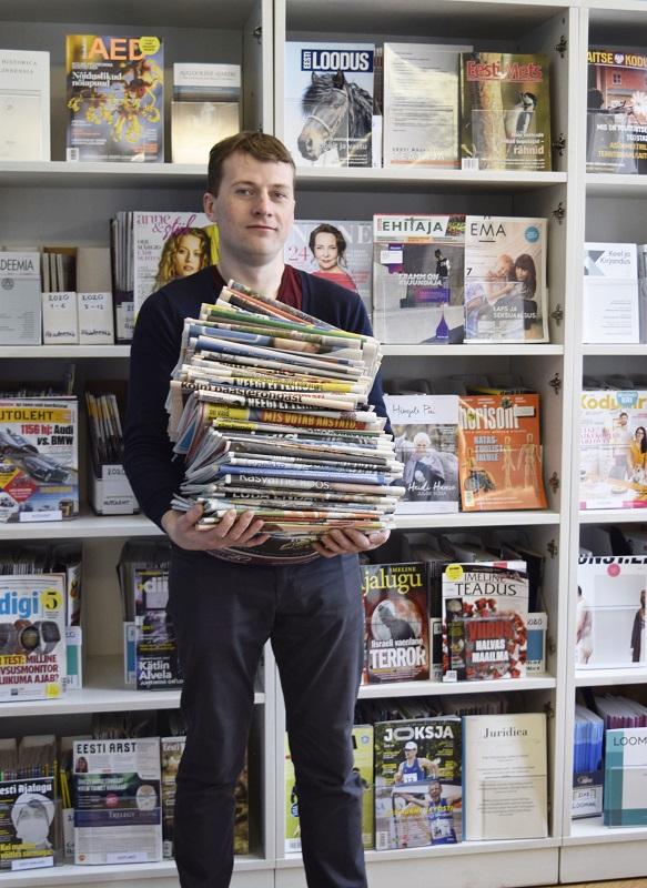 noormees ajalehtedega